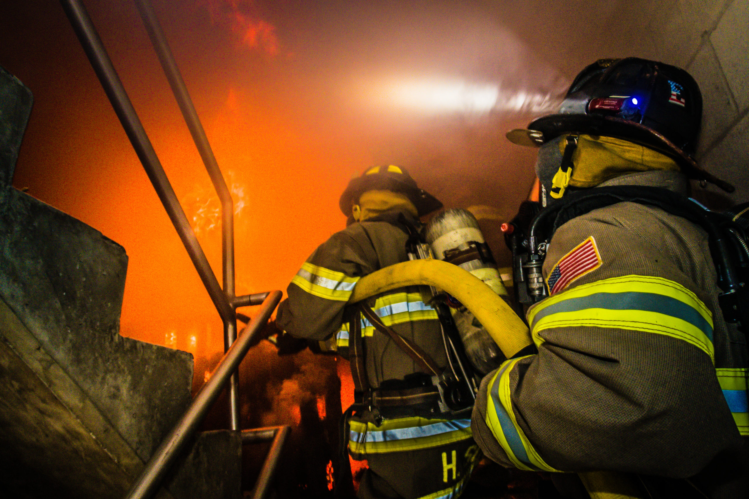 Firefighter training inside a burning building
